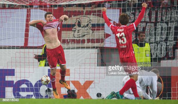Dominique Heintz of Koeln and Yuya Osako celebrate their teams third goal during the UEFA Europa League group H match between 1 FC Koeln and BATE...