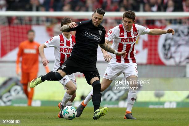 Dominique Heintz of Koeln challenges Daniel Ginczek of Stuttgart during the Bundesliga match between 1 FC Koeln and VfB Stuttgart at...