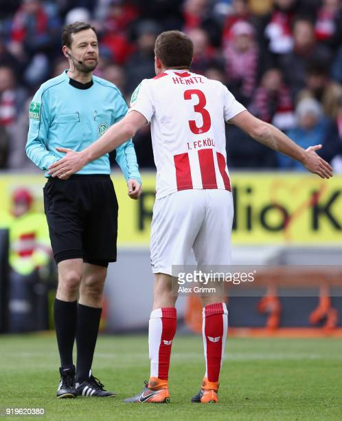 Dominique Heintz of Koeln discusses with referee Markus Schmidt during the Bundesliga match between 1 FC Koeln and Hannover 96 at RheinEnergieStadion...
