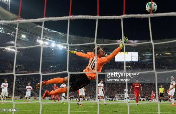 Dominique Heintz of Koeln scores his team's first goal past goalkeeper RonRobert Zieler of Stuttgart during the Bundesliga match between VfB...