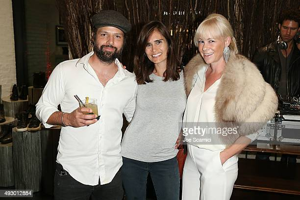 Dominique Houriet with wife and Gillian Flynn attend the John Varvatos San Diego Store Opening on October 16 2015 in San Diego California
