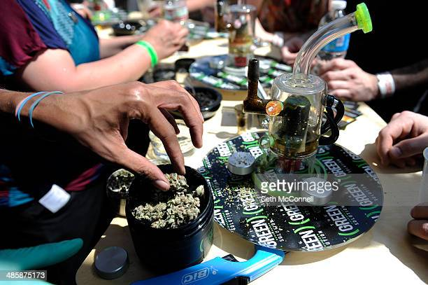 Dominique Houston of Denver packs a bowl for an attendee to sample at the Green Solution booth during the High Times Cannabis Cup at Denver Mart in...