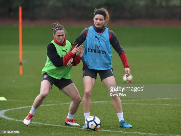 Dominique Janssen and Heather O'Reilly of Arsenal during an Arsenal Women Training Session at London Colney on March 12 2018 in St Albans England