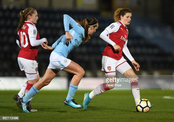 Dominique Janssen of Arsenal takes on Jill Scott of Man City during the match between Arsenal Women and Manchester City Ladies at Adams Park on March...