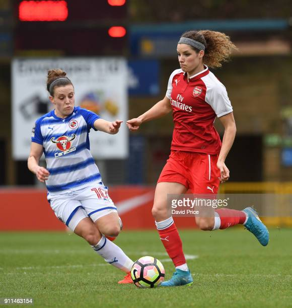 Dominique Janssen of the Arsenal takes on Lauren Bruton of Reading during the match between Reading FC Women and Arsenal Women at Adams Park on...
