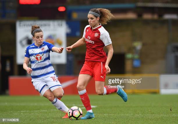 Dominique Janssen of the Arsenal Women takes on Lauren Burton of Reading during the match between Reading FC Women and Arsenal Women at Adams Park on...