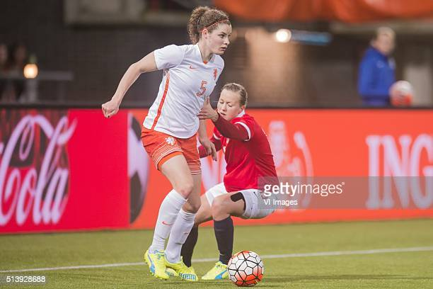 Dominique Janssen of the Netherlands Kristine Minde of Norway during the 2016 UEFA Women's Olympic Qualifying Tournament match between Norway and...