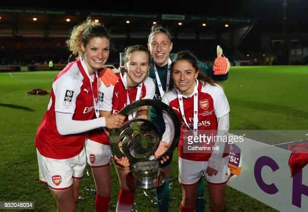 Dominique Janssen Vivianna Miedema Sari Van Veenedaal and Danielle Van De Donk of Arsenal Women celebrate with the trophy after the WSL Continental...