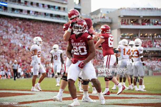 Dominique Johnson of the Arkansas Razorbacks celebrates after scoring a touchdown in the first half of a game against the Texas Longhorns at Donald...