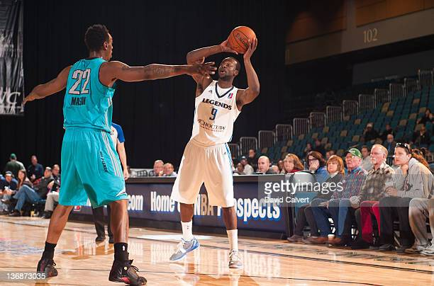 Dominique Johnson of the Texas Legends looks to pass guarded by Anthony Mason of the Sioux Falls Skyforce during the 2012 NBA D-League Showcase on...