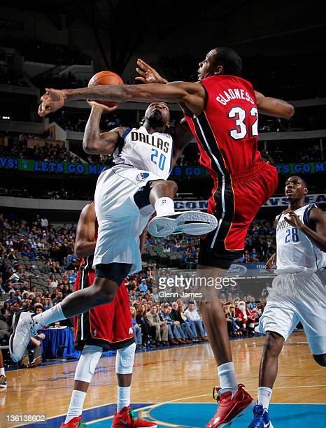 Dominique Jones of the Dallas Mavericks goes up for a shot attempt against Mickell Gladness of the Miami Heat on December 25, 2011 at the American...
