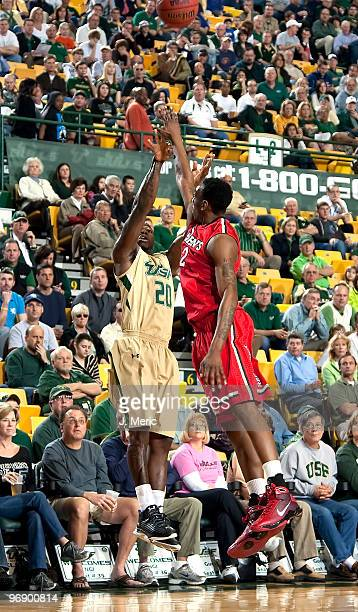 Dominique Jones of the South Florida Bulls shoots over Anthony Mason, Jr. #2 of the St John's Red Storm during the game at the SunDome on February...