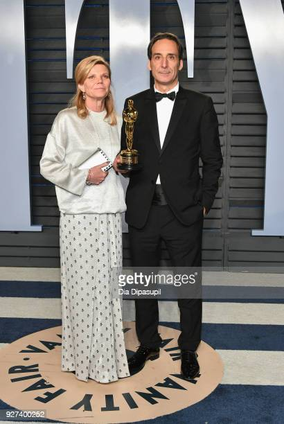 Dominique Lemonnier and Alexandre Desplat attend the 2018 Vanity Fair Oscar Party hosted by Radhika Jones at Wallis Annenberg Center for the...