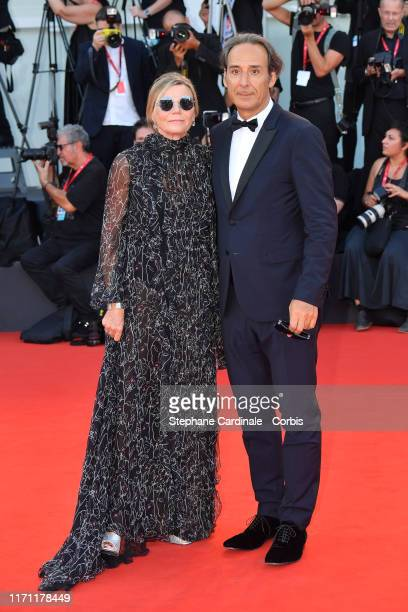 """Dominique Lemonnier and Alexandre Desplat walk the red carpet ahead of the """"J'Accuse"""" screening during the 76th Venice Film Festival at Sala Grande..."""