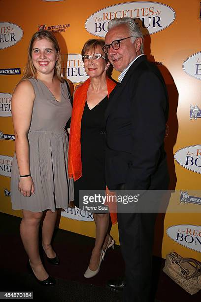 Dominique Loiseau her daughter Blanche and Alain Ducasse attend 'the HundredFoot Journey' Paris Premiere at Cinema Gaumont Marignan on September 7...