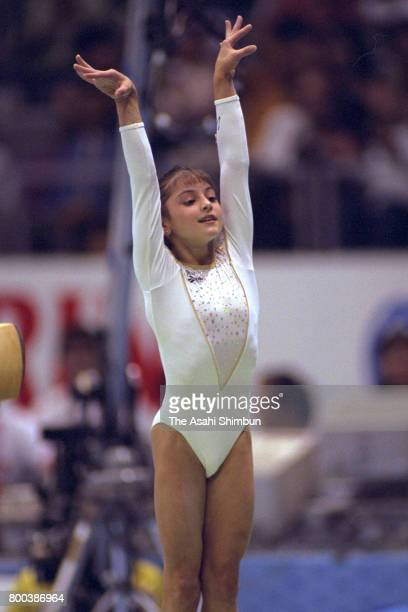 Dominique Moceanu of the United States reacts after competing in the Balance Beam of the Women's apparatus finals during the Artistic Gymnastic World...