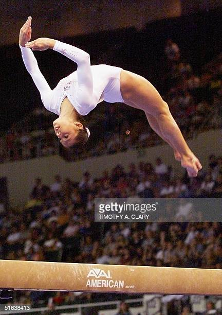 Dominique Moceanu of the US Gymnastic team goes through her routine on the balance beam during the Women's all around individual competition at the...