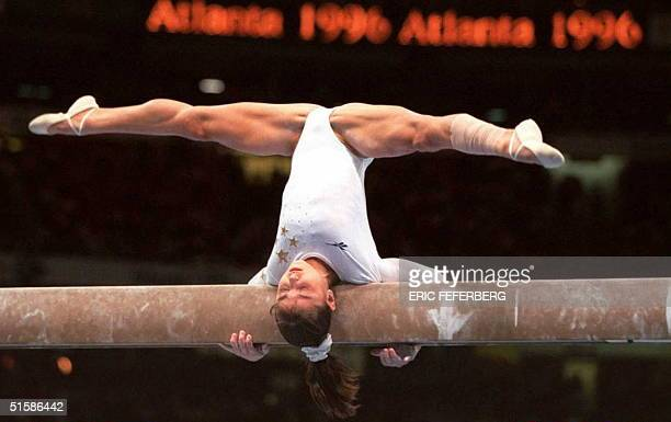 Dominique Moceanu of the US performs on the balance beam during the Olympic women's individual allround gymnastics competition 25 July Reigning world...