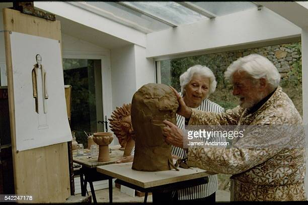 Dominique Moncorgé watches Jean Marais at work in his studio after commissioning the bust