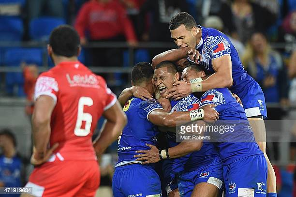 Dominique Peyroux of Samoa celebrates scoring a try with team mates during the International Test Match between TOA Samoa and Tonga at Cbus Super...