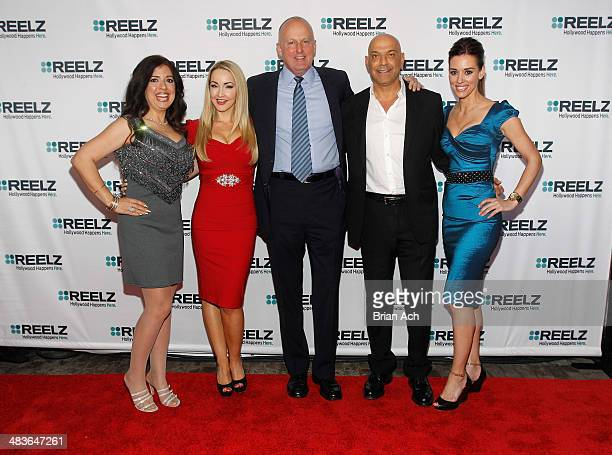 Dominique Pinassi and Aria Johnson of Beverly Hills Pawn CEO of Reelz Stan E Hubbard and Yossi Dina and Cory Oliver of Beverly Hills Pawn attend the...