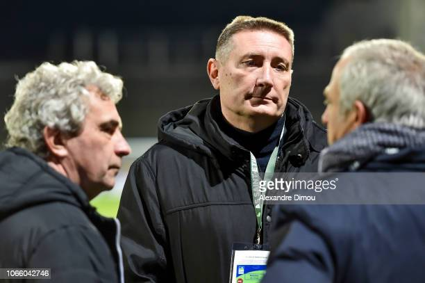 Dominique Rocheteau and Frederic Paquet of Saint Etienne and Alain Roche during the French League Cup match between Nimes Olympique and AS Saint...