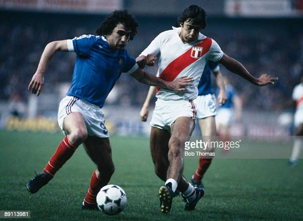 Dominique Rocheteau of France is challenged by Peru's Leguia during the International friendly match at the Parc Des Princes Stadium in Paris 28th...