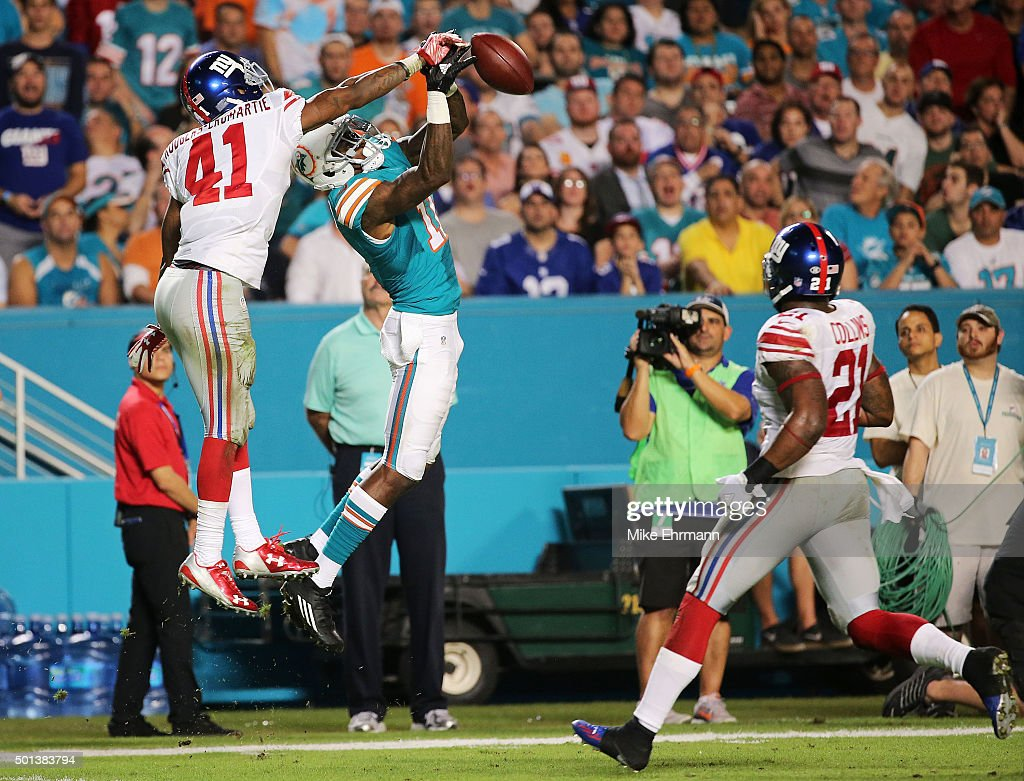 Dominique Rodgers-Cromartie #41 of the New York Giants breaks up a pass intended for DeVante Parker #11 of the Miami Dolphins during the second half of the game at Sun Life Stadium on December 14, 2015 in Miami Gardens, Florida.