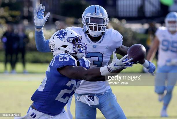 Dominique Ross of the North Carolina Tar Heels breaks up a pass to Deon Jackson of the Duke Blue Devils during their game at Wallace Wade Stadium on...