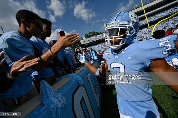 Dominique Ross of the North Carolina Tar Heels greets fans during their game against the Appalachian State Mountaineers at Kenan Stadium on September...