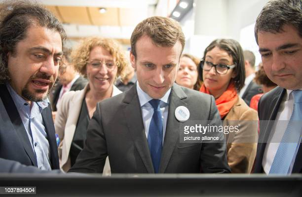 Dominique Salloum, CEO of bioptimize , French Minister of Economic Affairs Emmanuel Macron and Jean Rottner, mayor of Mulhouse, at the stand of...