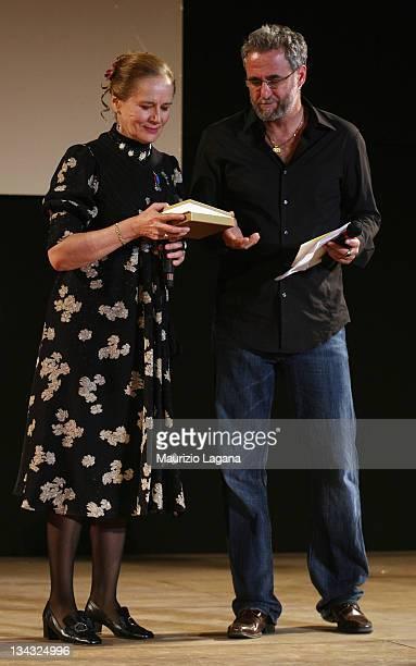 Dominique Sanda receives the Taormina Art Award from director Ari Folman during Taormina Film Festival at Greeece Theatre on June 18 2009 in Taormina...