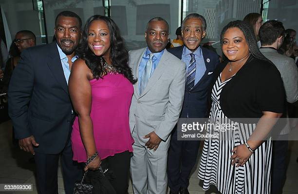 Dominique Sharpton LeVar Burton Al Sharpton and Ashley Sharpton attend the premiere screening of Night One of the four night epic event series Roots...