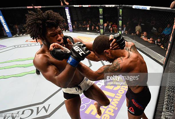 Dominique Steele exchange punches with Danny Roberts of England in their welterweight bout during the UFC 197 event inside MGM Grand Garden Arena on...
