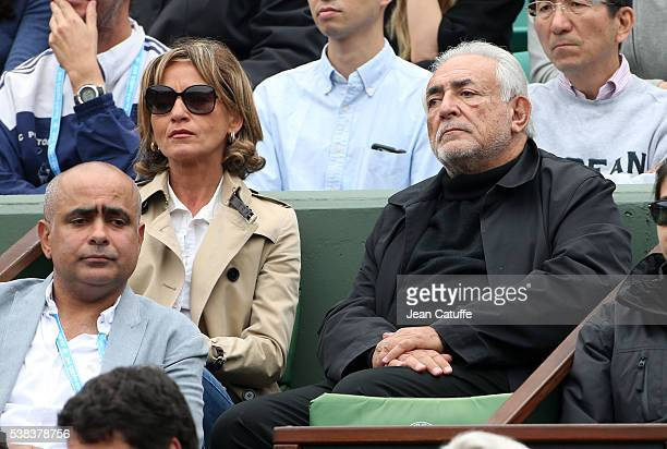Dominique Strauss Kahn aka DSK and his girlfriend Myriam L'Aouffir attend the Men's Singles final between Novak Djokovic of Serbia and Andy Murray of...