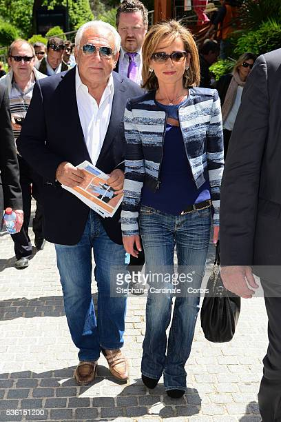 Dominique Strauss Kahn and Myriam L'Aouffir attend the 2015 Roland Garros French Tennis Open Day Seven on May 30 2015 in Paris France