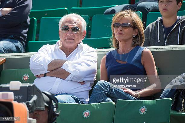 Dominique Strauss Kahn and Myriam L'Aouffir attend the French Open 2015 at Roland Garros on May 30 2015 in Paris France