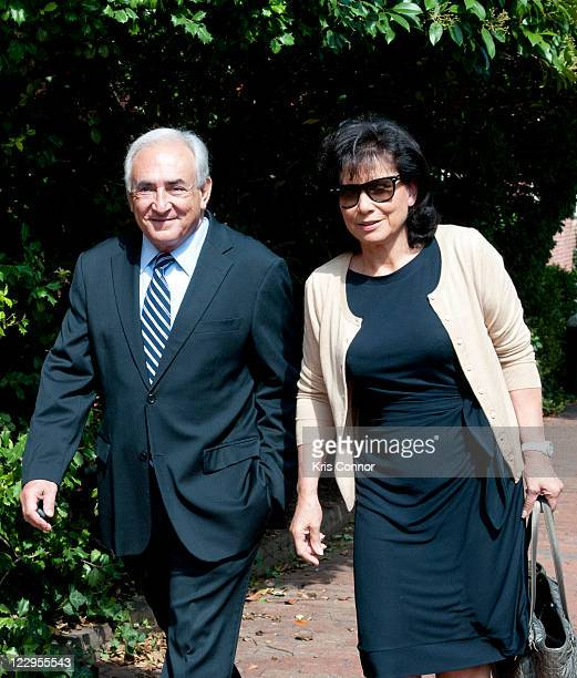 Dominique StraussKahn and Anne Sinclair are seen outside their home on Dumbarton street in the neighborhood of Georgetown on August 29 2011 in...