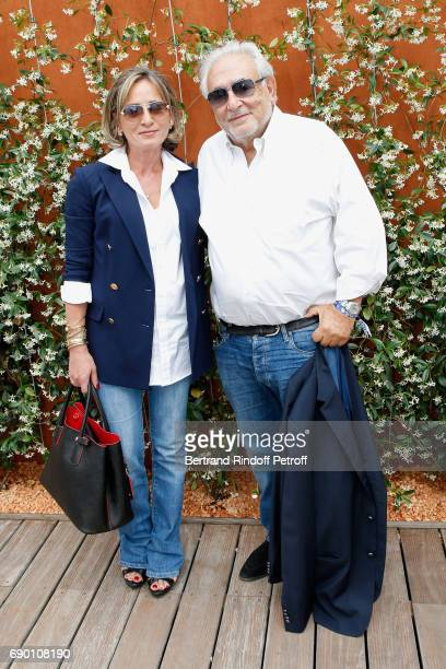 Dominique StraussKahn and his companion Myriam L'Aouffir attend the 2017 French Tennis Open Day Three at Roland Garros on May 30 2017 in Paris France