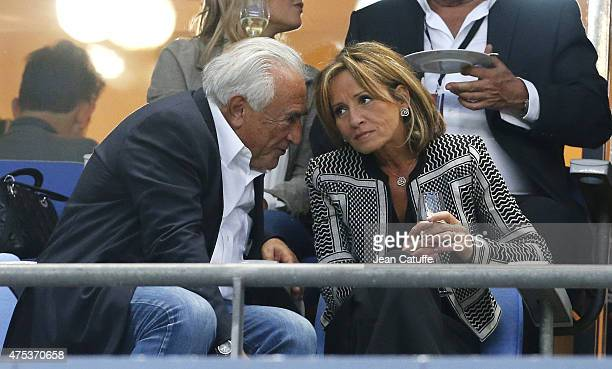 Dominique StraussKahn and his girlfriend Myriam L'Aouffir attend the French Cup Final between Paris SaintGermain and AJ Auxerre at Stade de France on...