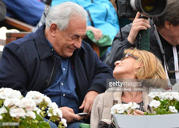 Dominique StraussKahn and his girlfriend Myriam L'Aouffir attend the men's Final Raphael Nadal vs David Ferrer during the French Tennis Open 2013 at...