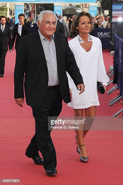Dominique StraussKahn and Myriam L'Aoufir arrive at the closing ceremony and the 'Sin City A Dame To Kill For' premiere during the 40th Deauville...