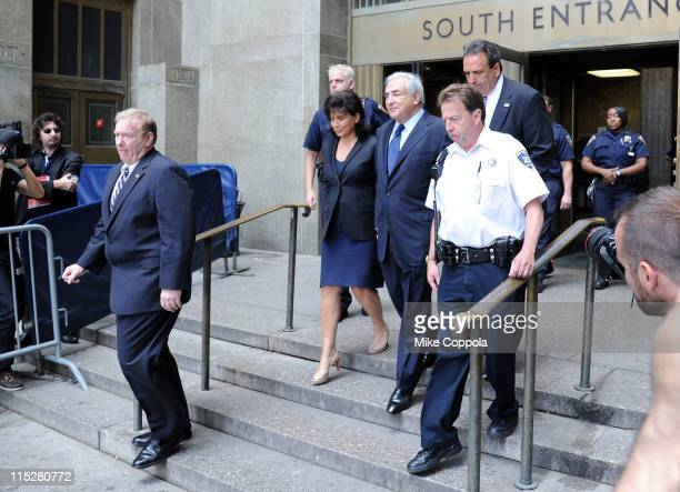 Dominique StraussKahn and wife Anne Sinclair leave Manhattan criminal court after his arraignment hearing o on June 6 2011 in New York City