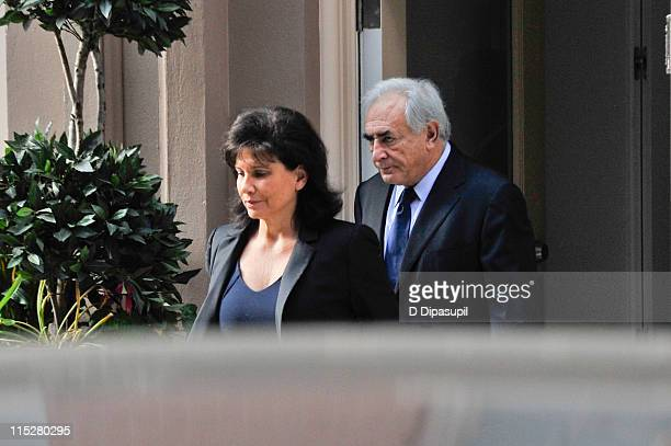 Dominique StraussKahn and wife Anne Sinclair leave their temporary residence in the TriBeCa neighborhood to travel to his arraignment hearing on June...