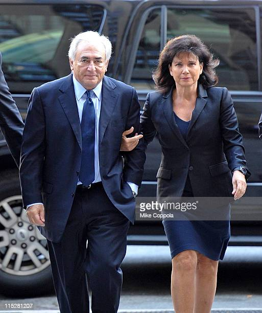 Dominique StraussKahn and wife Anne Sinclair walk up the steps of Manhattan criminal court on June 6 2011 in New York City