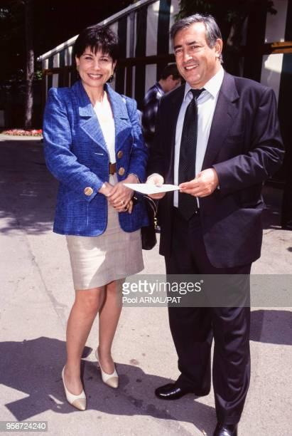 Dominique StraussKahn et Anne Sinclair lors du tournoi de RolandGarros à Paris en juin 1995 France