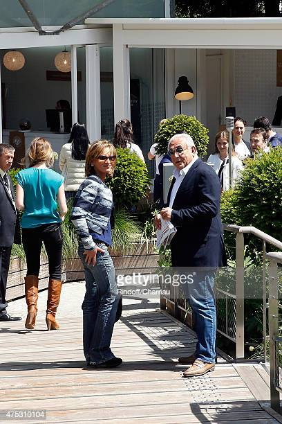 Dominique StraussKhan and Myriam L'Aouffir attend the French Open at Roland Garros on May 30 2015 in Paris France