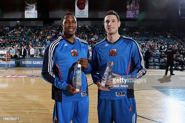 Dominique Sutton of the Tulsa 66ers and Andy Rautins of the Tulsa 66ers presented with the Slam Dunk trophy and the ThreePoint trophy during the 2013...