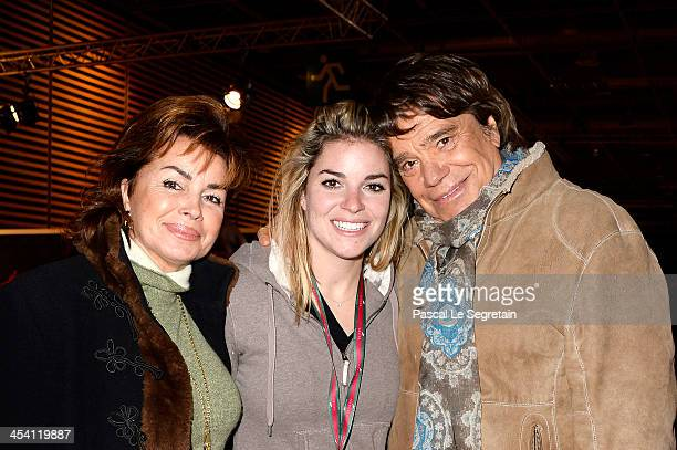 Dominique Tapie Sophie Tapie and Bernard Tapie attend the Gucci Paris Masters 2013 on December 7 2013 in Paris France