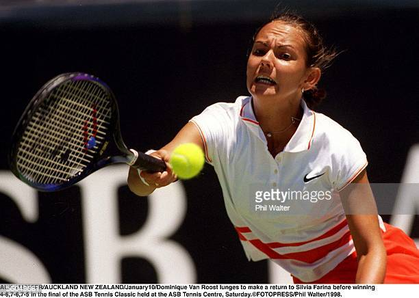 Dominique Van Roost is dwarfed by the winners trophy after beating Silvia Farina 4675 in the final of the ASB Tennis Classic held at the ASB Tennis...